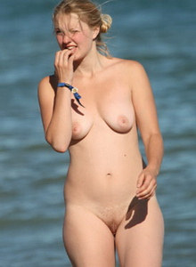 beach nudists   nude people enjoying being naked at the